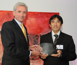 Ciro Tokasiki receives his award